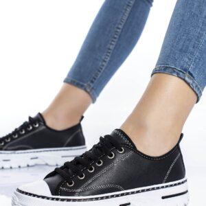 حذاء رياضي جلد أسود نسائي